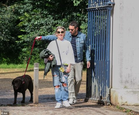 Puppy love: The pair were seen at a west London park on Sunday with her pet pooch Hurley - whom Lisa shares custody with ex Ant