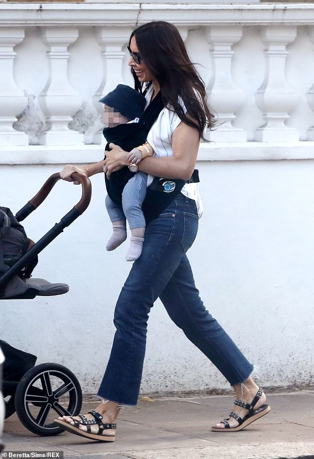 Doting mother: Christine Lampard, 42, looked every bit the doting mother on Friday as she took her son Freddie for a stroll