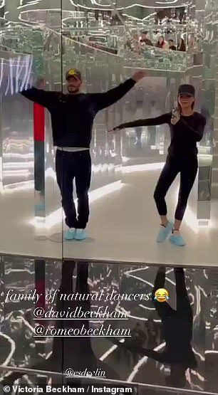 Funny: The couple were certainly enjoying themselves in the mirror experience