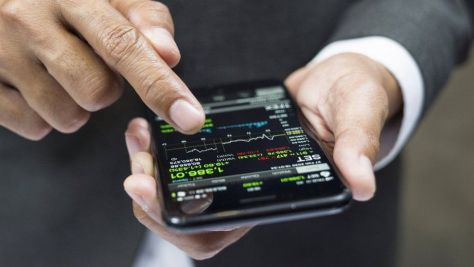 A man buying crypto-currencies on a mobile app