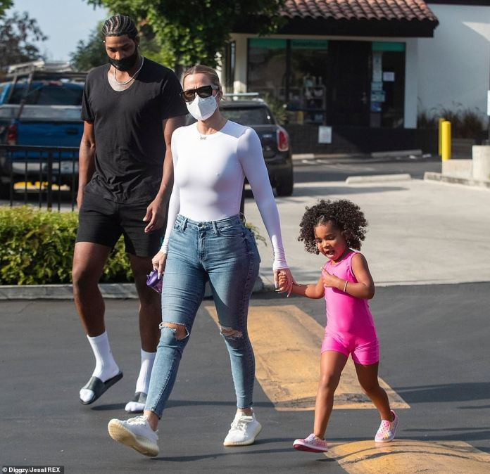 Socks and sandals: Radiating a relaxed attitude, the newly crowned Sacramento King wore high socks with slip-on Louis Vuitton sandals
