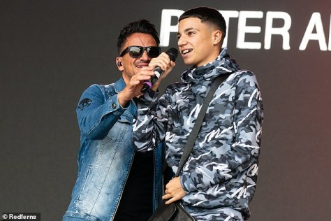 Confident: Dressed head-to-toe in a grey camouflage tracksuit and a black checkered man bag, the son of glamour model Katie , 43, leaped at the opportunity to perform on-stage