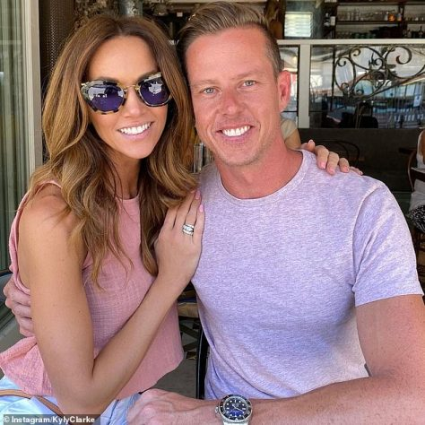 Over: Meanwhile, Kyly enjoyed a fling with V8 Supercars champion James Courtney last year - however they too split up in December