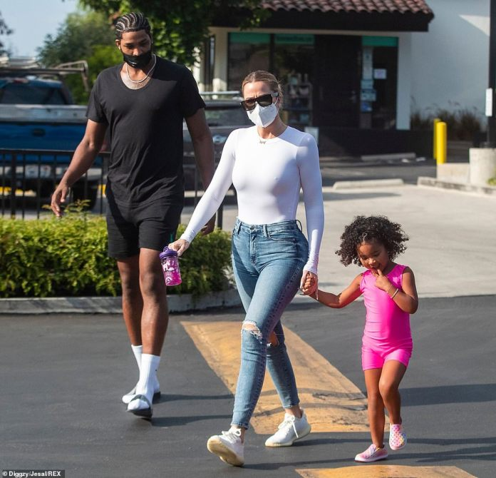 Happy family: Khloe Kardashian and Tristan Thompson looked like happy co-parents while bringing daughter True, three, to gymnastics class in Woodland Hills, California on Monday