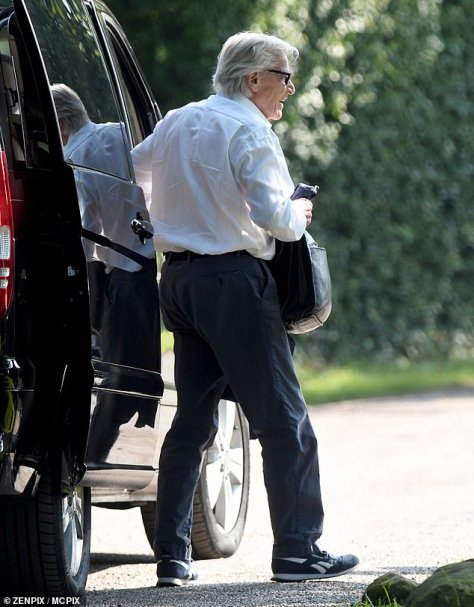 Change of outfit: When actor Bill Roache arrived on the Manchester set he was wearing casual trousers and trainers