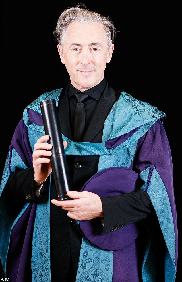 Proud: Alan Cumming, 56, has been awarded an honorary doctorate from his alma mater drama school, the Royal Conservatoire of Scotland