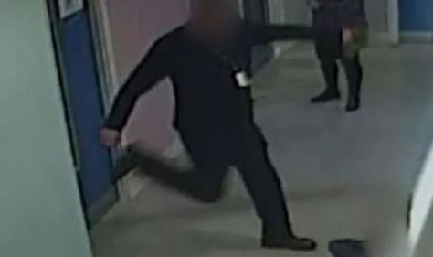 In a brutal attack on CCTV, a police officer assaults ten-year old boy
