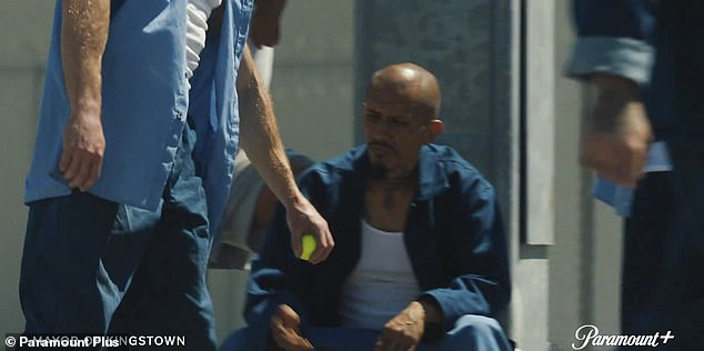Prison:Mike is seen giving a tennis ball to a young kid, who hits it over the prison walls, as the ball is given to an inmate who removes a flash drive from it