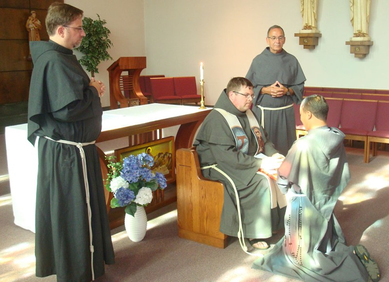 On July 19, 2015, in the Chapel of Archbishop Curley High School, friar Maximilian Avila, OFM Conv. (kneeling) renewed his Simple Vows during Evening Prayer. Friary Guardian, Fr. Matthew Foley, OFM Conv. (seated), accepted his vows on behalf of our Minister Provincial. The vow renewal was witnessed by Br. Jim Moore, OFM Conv. (standing right) and Fr. Gary Johnson, OFM Conv. (standing left).