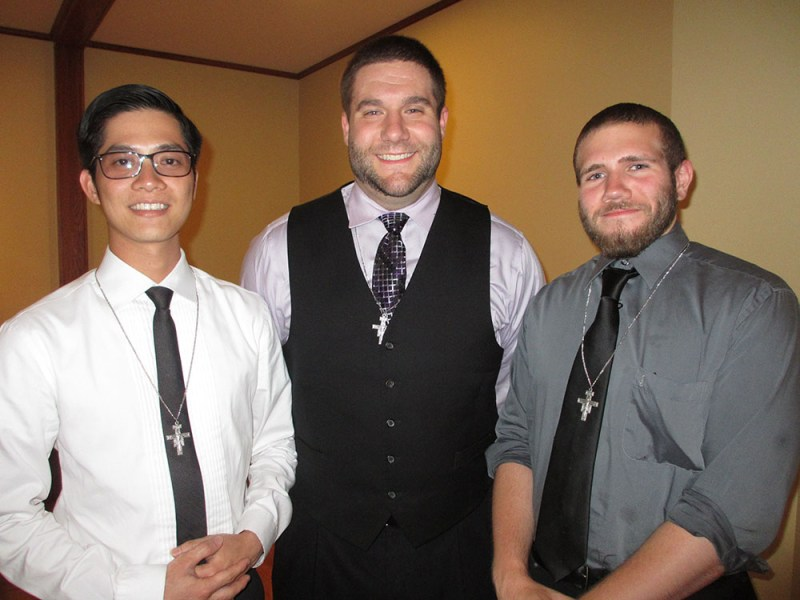 "On July 22, 2015 at the National Shrine of St. Maximilian Kolbe at Marytown, (L-R) ) Mr. Ky Bui, Mr. Jonathan Byrum, and Mr. Jason DiMartini began their postulancy with the Our Lady of the Angels Province. 45 friars from around the country gathered to welcome the young men into ""Beginning Fraternity"" with the Franciscan Friars Conventual."