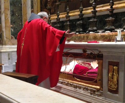 Fr. Tim Kulbicki, OFM Conv. offers prayers for the intentions of the Companions of St. Anthony during Mass at the tomb of Saint Pope John XXIII in St. Peter's Basilica at the Vatican in Rome.