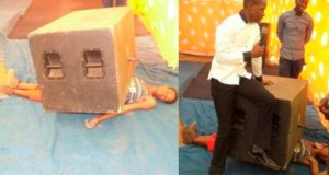 Prophet Lethebo putting a speaker on top a woman's body