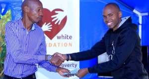 Bryan White Embraced Alex Muhangi