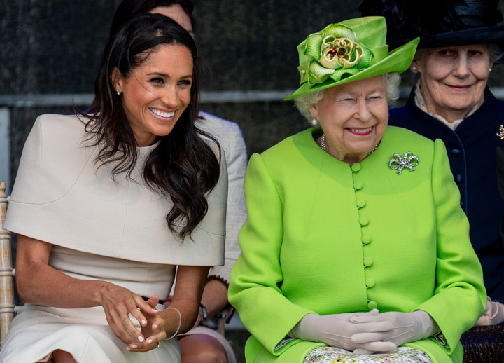 Queen Elizabeth II and Meghan, Duchess of Sussex, during a visit to the Catalyst Museum in Widnes, England, on June 14.