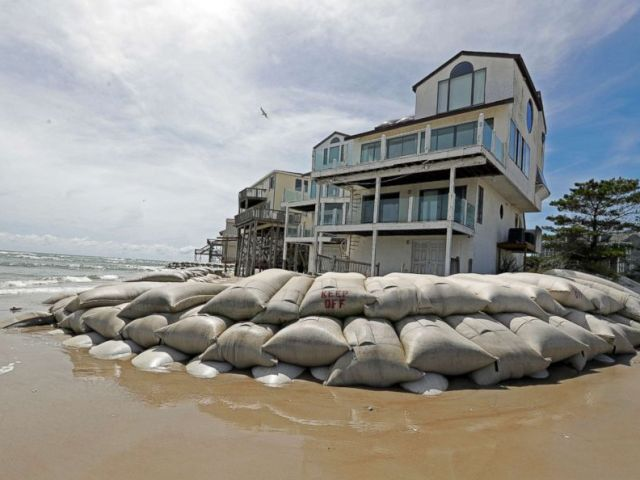 PHOTO: Sand bags surround homes on North Topsail Beach, N.C., Sept. 12, 2018, as Hurricane Florence threatens the coast.