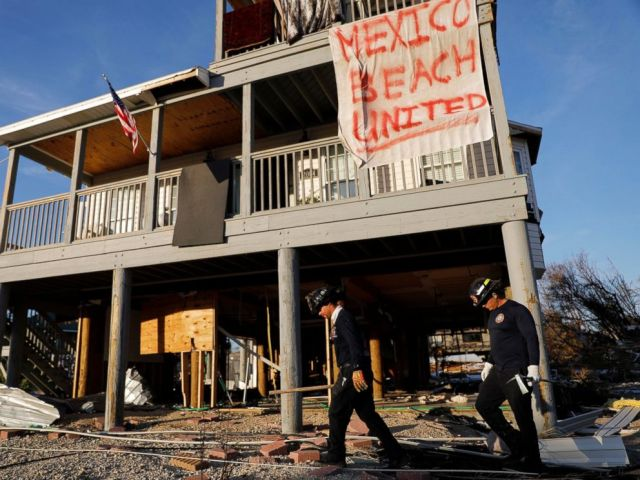 PHOTO: A banner hangs from a damaged home as a South Florida urban search and rescue team checks for survivors of hurricane Michael in Mexico Beach, Fla., Friday, Oct. 12, 2018.