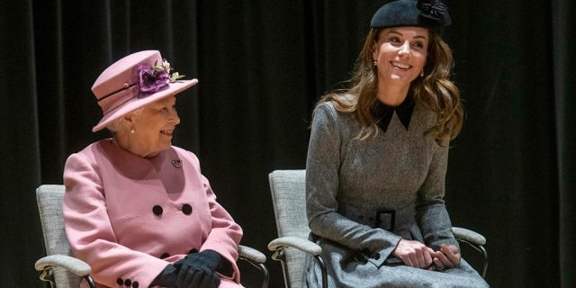 Britain's Queen Elizabeth II and Kate Duchess of Cambridge unveil a plaque at King's College London to open Bush House South Building, the latest education and learning facilities at the Strand Campus, in London, Tuesday March 19, 2019.