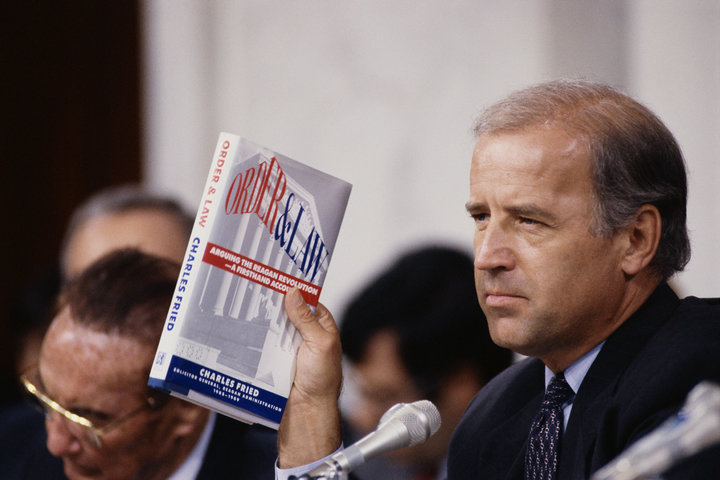 Joe Biden, then chairman of the Senate Judiciary Committee, holds up the book <i>Order and Law</i> by Charles Fried during th