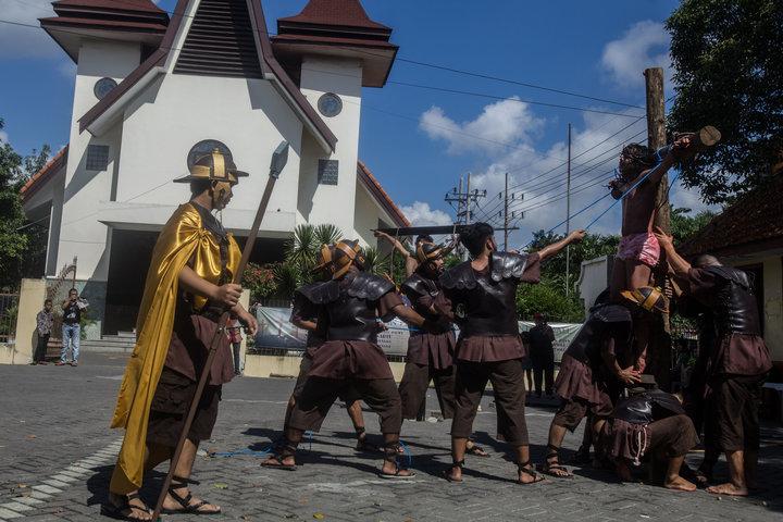 Christians reenact the crucifixion of Jesus in Surabaya, East Java.