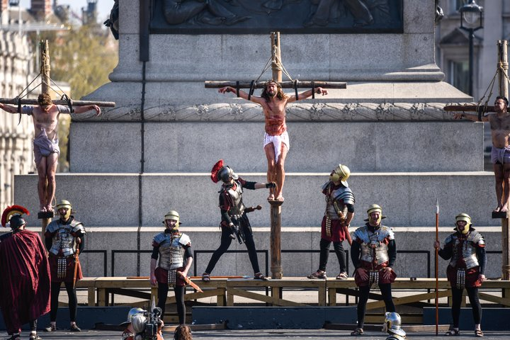 Actors reenact the crucifixion in front of crowds in Trafalgar Square on Good Friday.