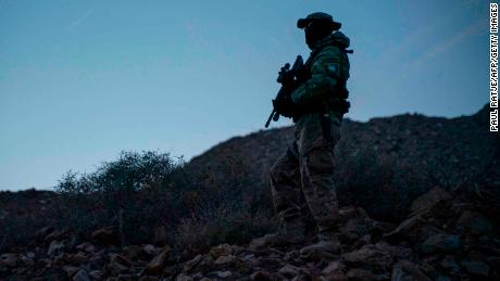 A member of United Constitutional Patriots is pictured patrolling near Mt. Christo Rey in Sunland Park, New Mexico, on March 20, 2019.