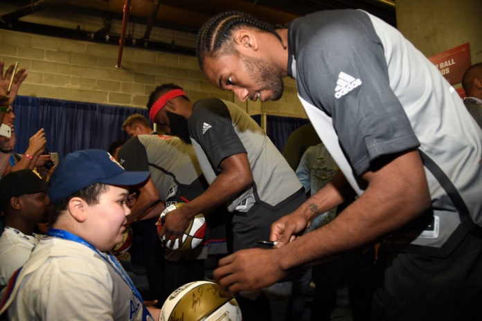 Kawhi Leonard signs autographs during the 66th NBA All-Star Game at Smoothie King Center on February 19, 2017 in New Orleans, Louisiana. (Photo by Kevin Mazur/Getty Images) thegrio.com