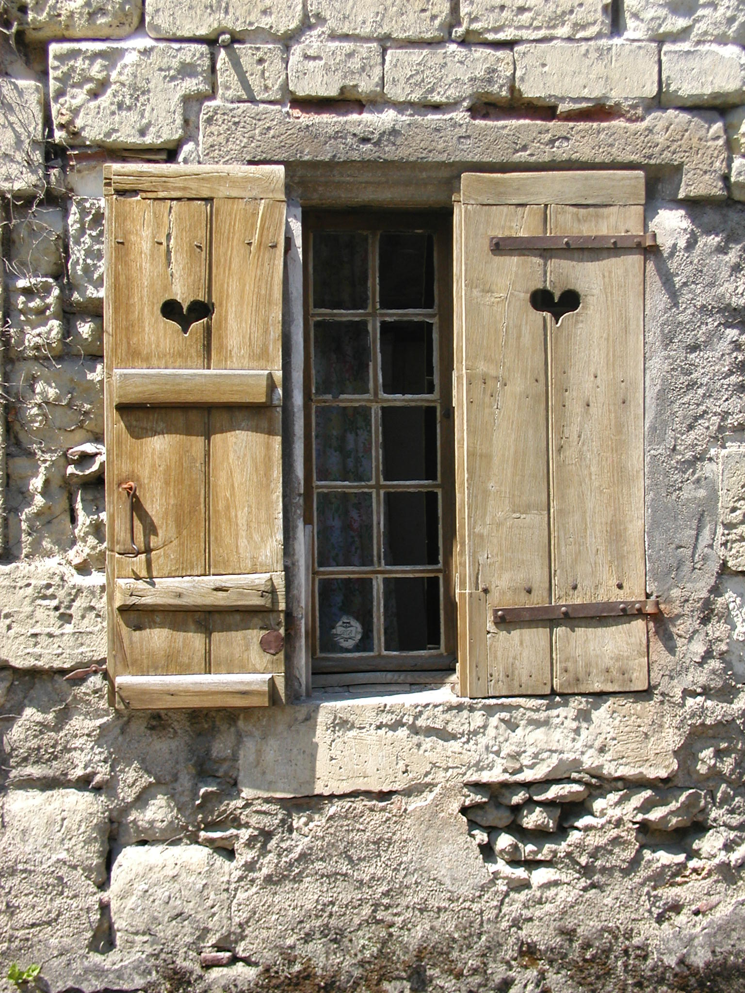 French board and batten shutters with strap hinges