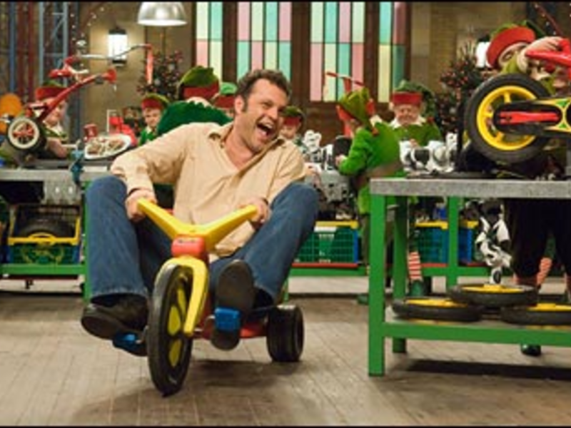 Trike Force: Vaughn peddles Fred Claus with all he?s got.