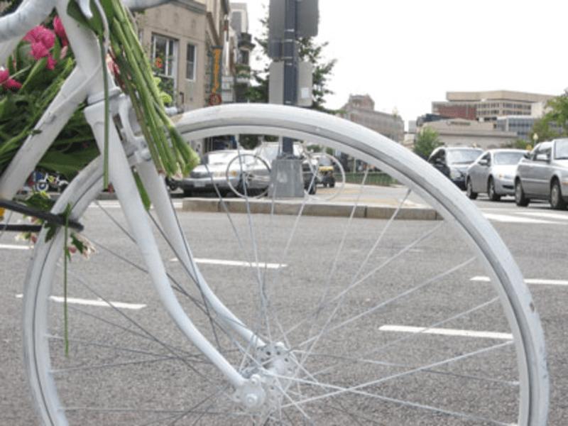 Wheel of a ghost bike memorializing a traffic fatality