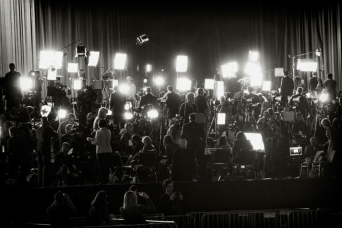 A large media group awaits U.S. President Barack Obama before his election night rally in Chicago.