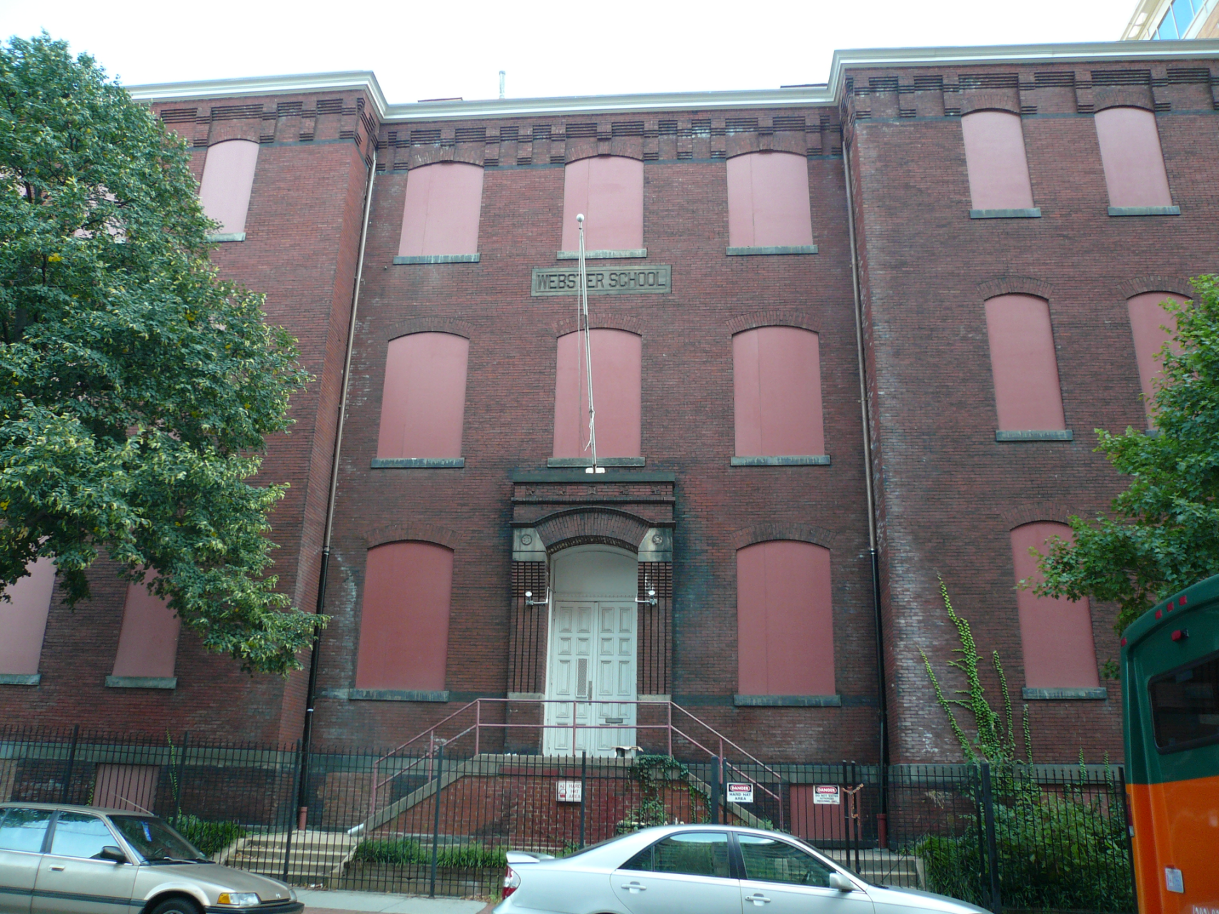 The Webster School, at 940 H Street NW, was built in 1882 as a 12-room schoolhouse. From 1925 until 1949, it was used as an Americanization school, where recent immigrants took citizenship classes, before being used for various purposes by the D.C. Public Schools. It was boarded up in the 1990s, and subsequent designation as an historic landmark halted plans to redevelop the building. Its been vacant ever since, and property records indicate that it's technically owned by the U.S. General Services Administration, which doesn't have to pay vacant property taxes. s been vacant ever since, and property records indicate that its technically owned by the U.S. General Services Administration, which doesn't have to pay vacant property taxes. s technically owned by the U.S. General Services Administration, which doesnt have to pay vacant property taxes. t have to pay vacant property taxes.