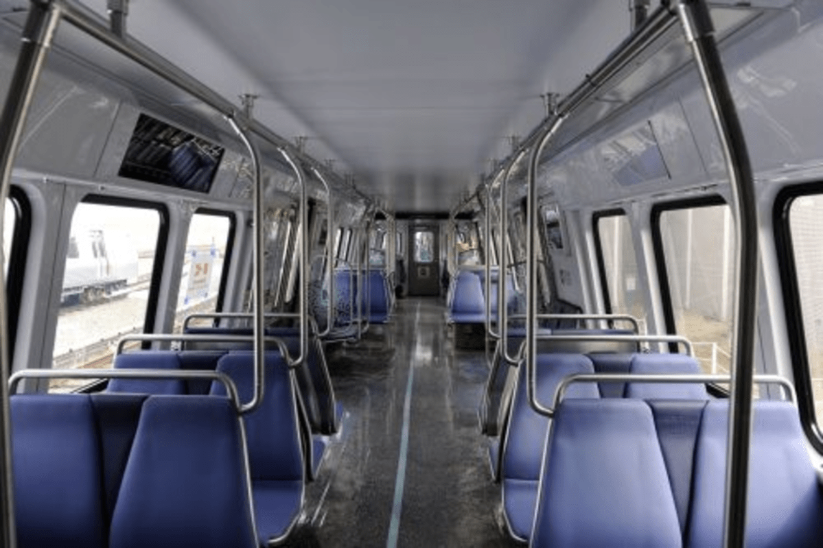 The new railcars feature wider aisles and digital displays.