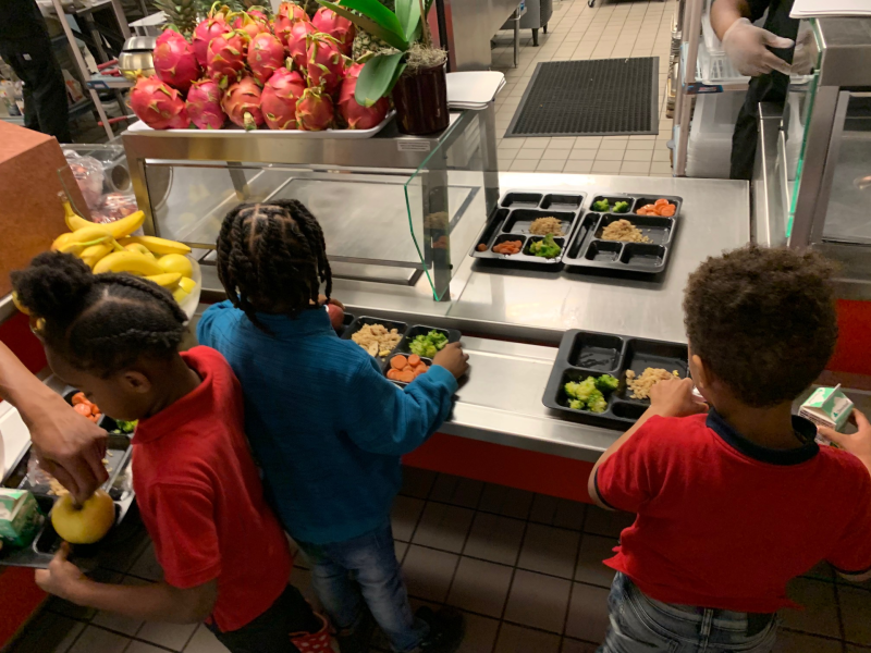 Students getting food during a normal day at Eagle Academy PCS