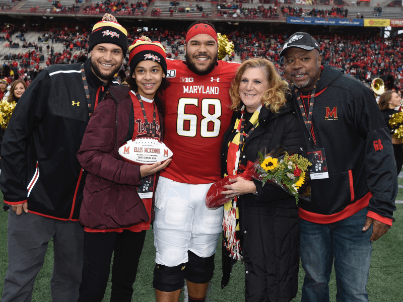 Ellis McKennie III with his parents, Jodi and Ellis Jr., and siblings, Stayce and Ava, on Marylands senior day last season.s senior day last season.