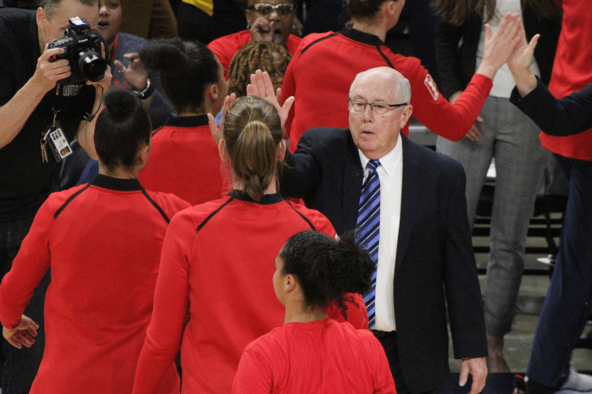 Mike Thibault high fives his players during the 2019 WNBA playoffs