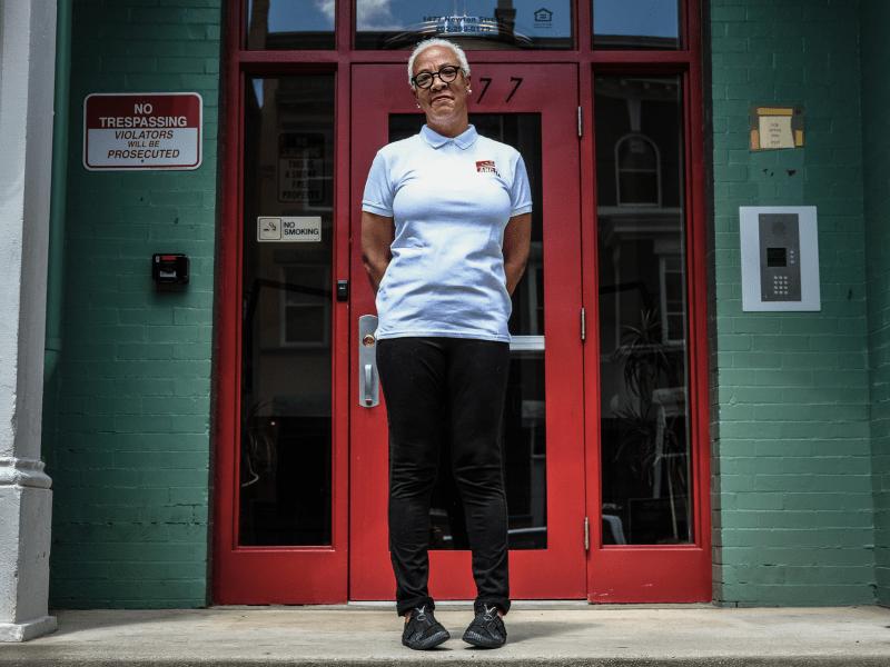 Teresa Edmondson outside 1477 Newton Street NW