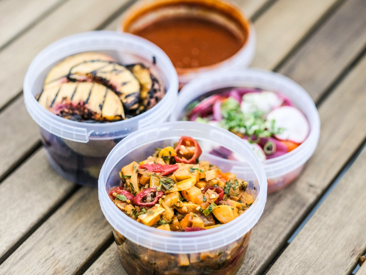 To-go containers of food from Feast