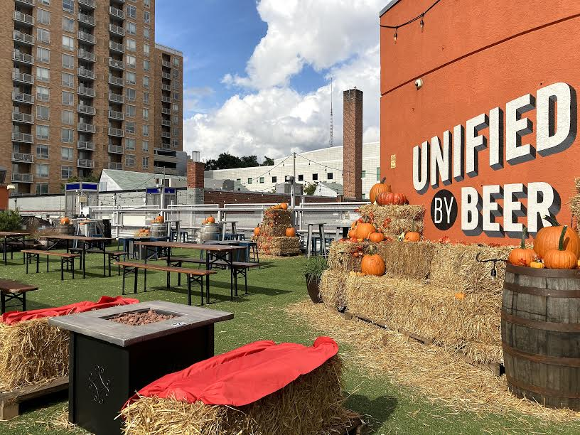 Beer garden with pumpkins at Denizens Brewing Co., where reservations are now available