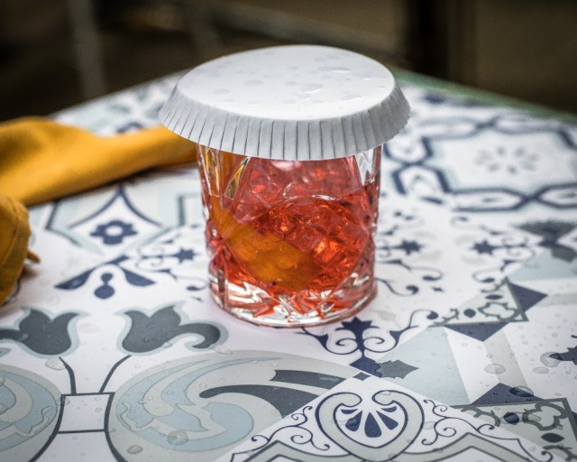 Cocktail with a coaster on top