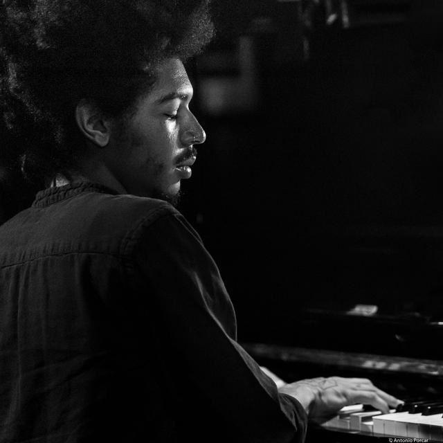 Davis Whitfield plays piano