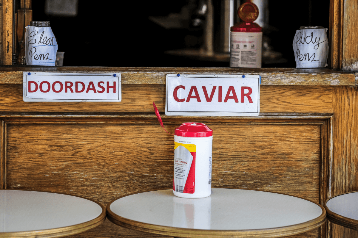 DoorDash and Caviar pick-up stations at a restaurant