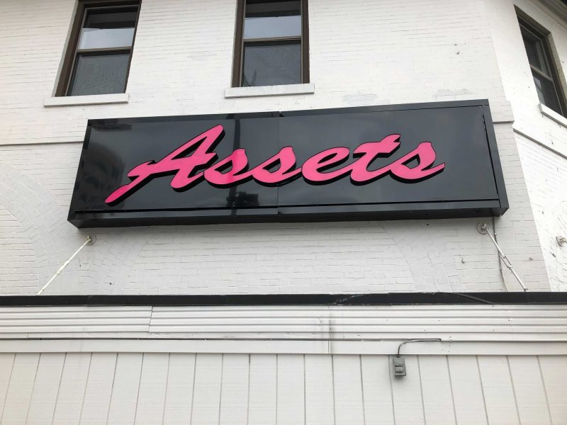 The Assets strip club sign