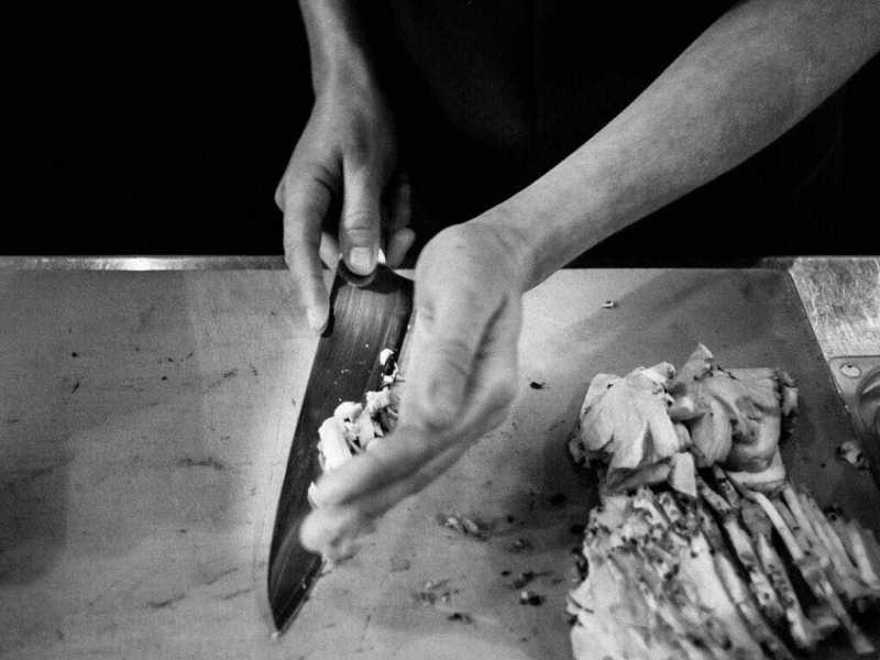 Line cook chopping vegetables