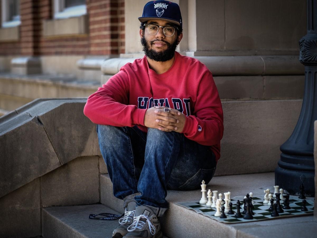 Howard University alum with chess set