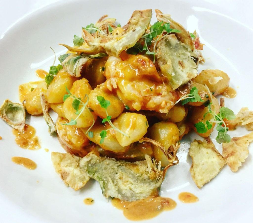 Potato gnocchi with crispy artichoke and a red and yellow pepper sauce