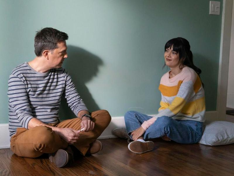 Patti Harrison and Ed Helms in Together Together.