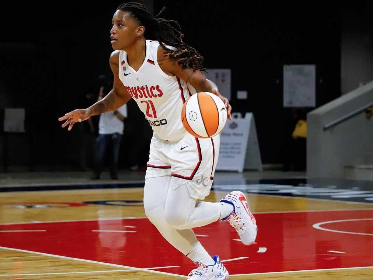 Shavonte Zellous dribbling basketball in Mystics jersey