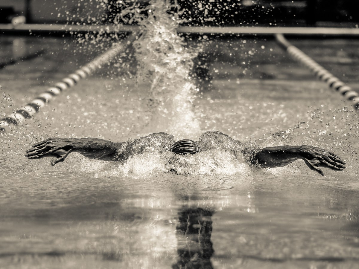 Lawrence Sapp mid-butterfly stroke in the pool