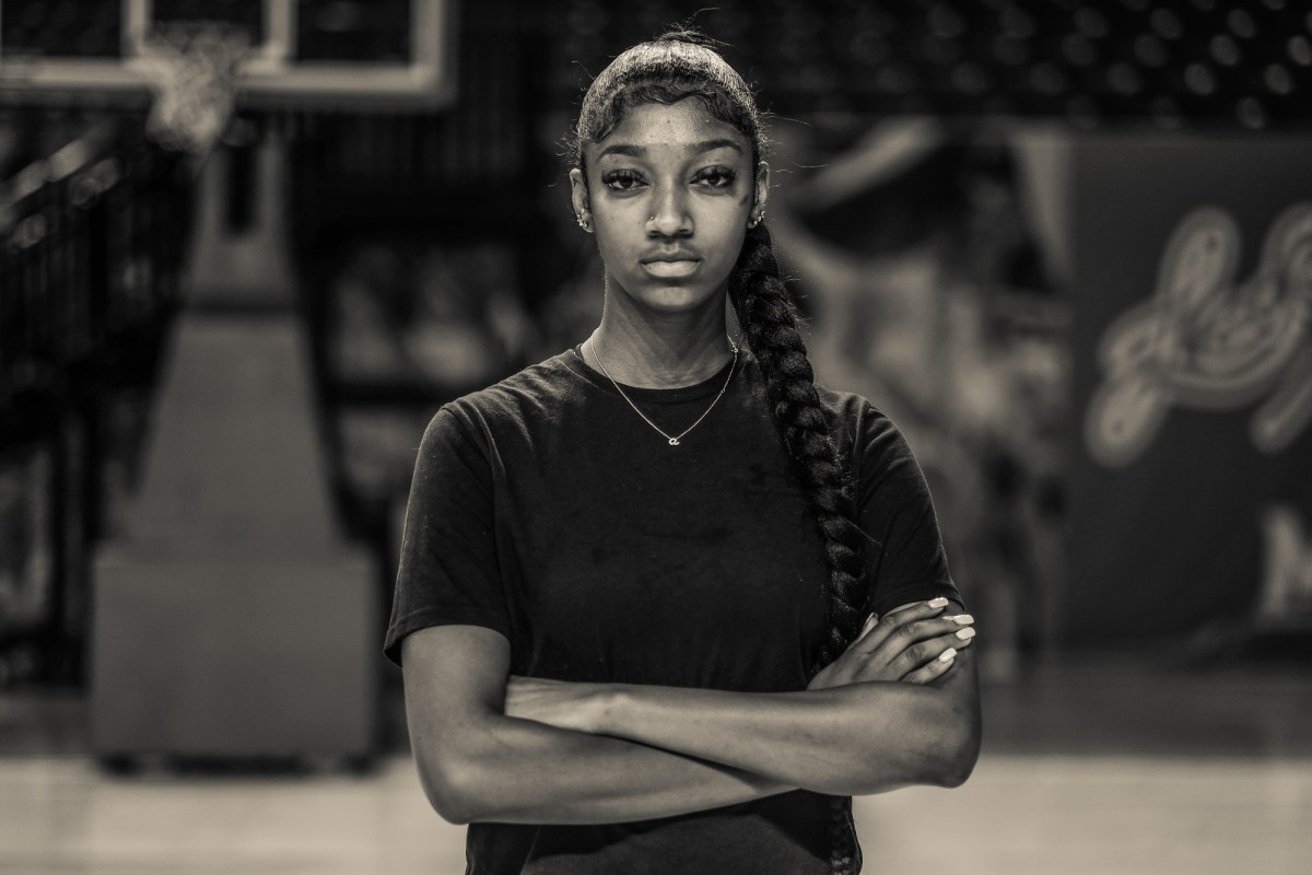 College athlete Angel Reese poses with her arms crossed