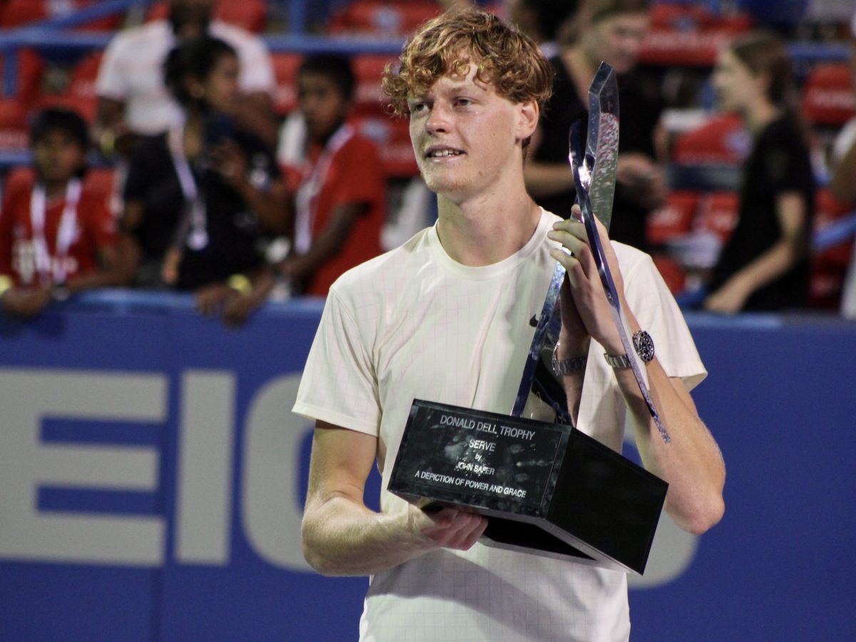 Jannik Sinner poses with his 2021 Citi Open champion trophy.